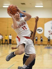 Red Hook's Nick Michitsch goes for a jump shot past  Poughkeepsie's Caval Haylett  during Wednesday's game at SUNY Ulster.