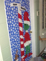 Girl Scouts troops decorated bedroom doors with hand-made