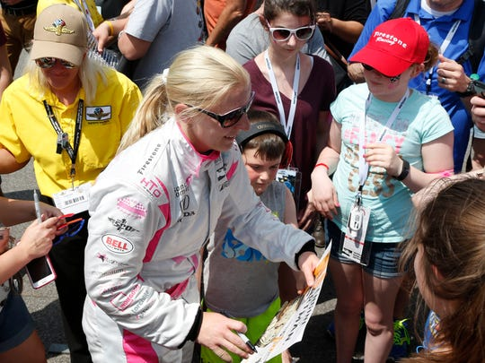 May 22, 2016; Indianapolis, IN, USA; Verizon Indy Car driver Pippa Mann signs autographs after qualifying for the Indianapolis 500 at Indianapolis Motor Speedway. Mandatory Credit: Brian Spurlock-USA TODAY Sports
