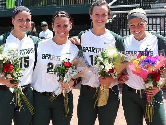 Alyssa McBride poses with Michigan State's other seniors following their final home game on May 2. McBride alleges she was hit intentionally during batting practice before the game.