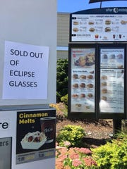 A West Salem McDonald's features a sign informing customers they have sold out of eclipse glasses on Friday, Aug. 18, 2018.