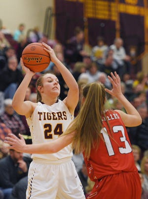 Harrisburg's Aby Phipps goes against Yankton defense during the game Thursday, Jan. 4, at Harrisburg.