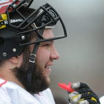 Maryland lineman and Red Lion high school graduate Andrew Zeller jokes around on the sidelines during an intersquad scrimmage at Byrd Stadium in College Park, Md. on Friday, April 4, 2014.