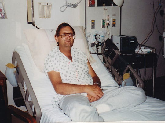 Delaware City resident Rick Haines is seen in his bed at Christiana Hospital just hours after receiving a bone marrow transplant in 1991.