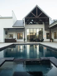 This $1.5 million home features an in-ground pool and