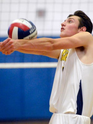 Victor's Cam Clark bump sets the ball during a regular season game against Penfield at Victor High School on Wednesday, Sept. 13, 2017.