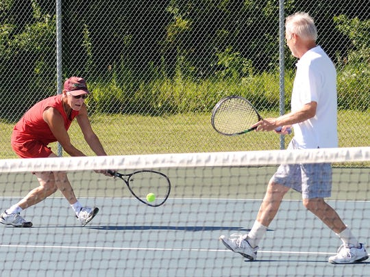 Allen Clady returns the volley Thursday afternoon at the Bucyrus Community Tennis Courts. The Tennis Crew have been playing twice a week at Bucyrus Community Tennis Courts for 40 years.