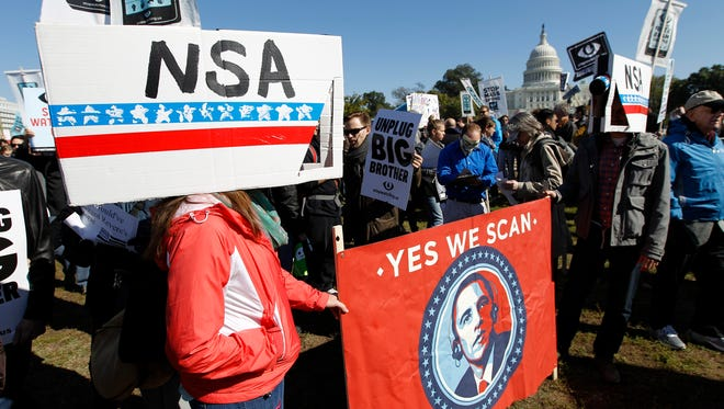 Demonstrators demand Congress investigate the National Security Agency's mass surveillance programs on Saturday.