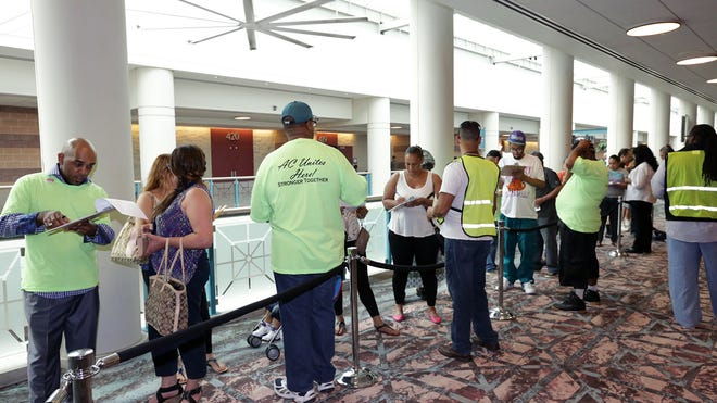 Union workers process recently unemployed casino workers, Wednesday Sept. 3, 2014, at the Atlantic City Convention Center, in Atlantic City, N.J., where a resource center is available to help them.