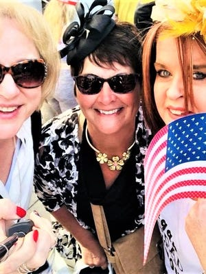 Tori Wilson and Deanna Radcliffe pose for a photo with a lady from Ireland while waiting for the Royal Wedding to begin in Windsor, England.