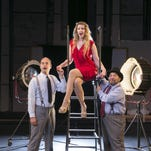 Theater producer Leo Bloom (Tim Marquette, left) and aspiring performer Ulla (Mindy Whitfield, center) are dazzled by the lights of Broadway. Fellow producer Max Bialystock (Leo Cortez, right) takes a more pragmatic approach.
