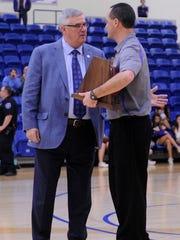 Wylie coach Kurt Richardson accepts the Region I-4A
