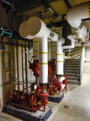 Large pumps move water in the geothermal system that heats and cools a cluster of new buildings, Thursday, June 8, at the St. Cloud VA Health Care System.