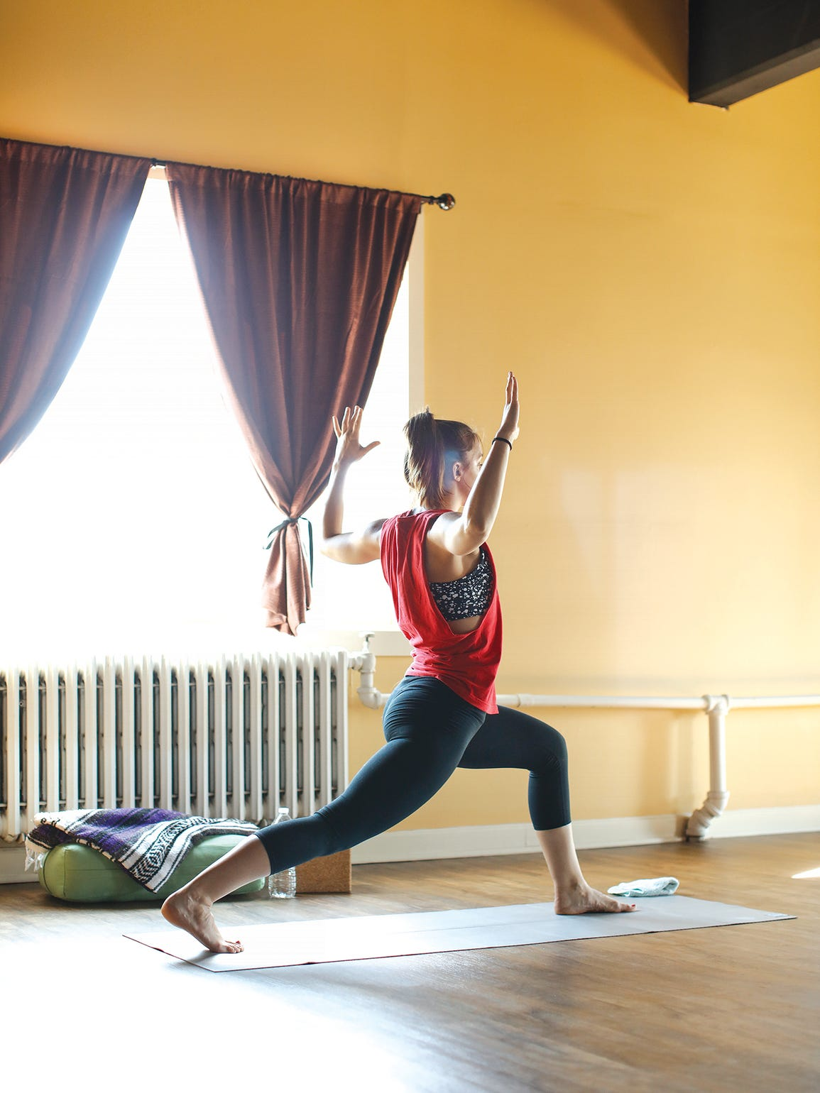 A student holds a pose at YogaVibe Rochester.