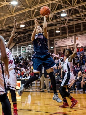 St. Thomas More's Megan Abrams (1) attempts a layup during the first half of an LHSAA girls' basketball game at Northside High School in Lafayette, LA, Monday, Jan. 26, 2015. Paul Kieu, The Advertiser