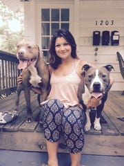 Danica Williams of Asbury Park with dogs Moose (left) and Patron (right). Both were diagnosed with cancer, and Patron received assistance from The Brodie Fund.