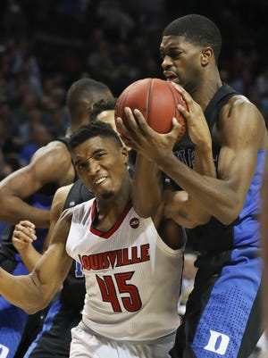 U of L's Donovan Mitchell (45) battled Duke's Amile Jefferson (21) for possession during the ACC Tournamment in Brooklyn. Mar. 9, 2017