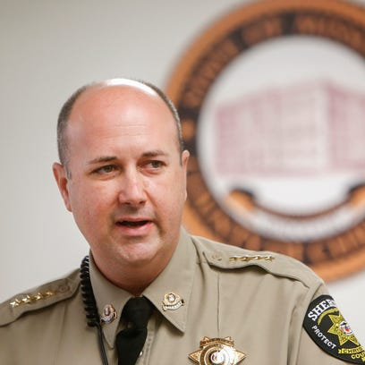 Christian County Sheriff Bob Cole speaks at a press