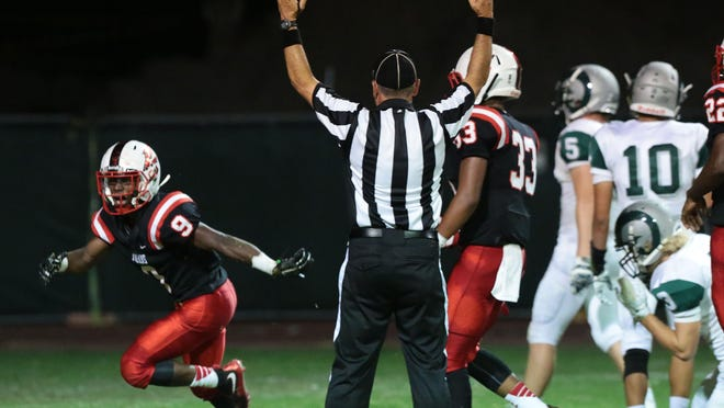 Palm Springs' Franklin Miller celebrates his touchdown against Murrieta Mesa on Saturday in Palm Springs.