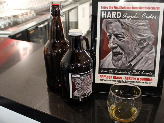 Between car galleries is an event space, with a bar that offers a hard cider made with apples from Red Lewis' orchard.