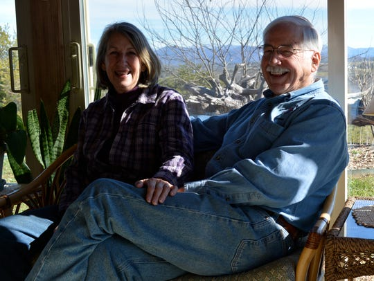 Chuck and Jeannie Blethen on a patio at their Jewel