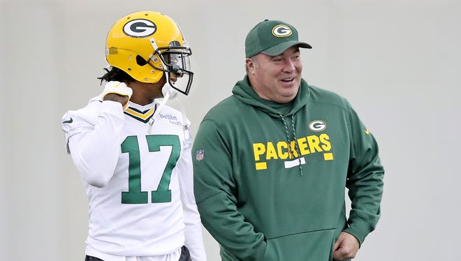 Green Bay Packers wide receiver Davante Adams (17) laughs along with coach Mike McCarthy during practice Tuesday, October 31, 2017 in the Don Hutson Cente.
