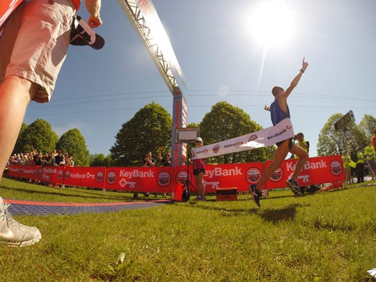 Tyler Andrews wins the KeyBank Vermont City Marathon Sunday.