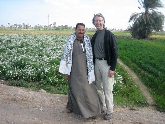 Rich Ahrens visits local farmer in an organic chammomile field in El Fayoun, Egypt.