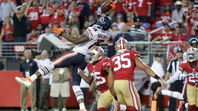 Chicago Bears wide receiver Brandon Marshall (15) catches a 17-yard touchdown pass between San Francisco 49ers safety Eric Reid (35) and strong safety Jimmie Ward (25) during the second quarter  in Santa Clara, Calif., Sunday, Sept. 14, 2014.