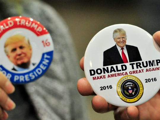 Supporters show off their presidential buttons for