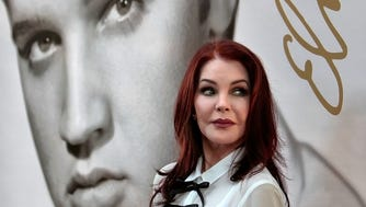 Priscilla Presley glances at a crowd of fans after the dedication ceremony for the new Elvis Forever stamp, the second postal stamp for the music icon Wednesday, Aug. 12, 2015, in Memphis.