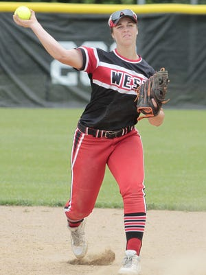 Allie Cummins of Lakota West slings the ball over to first to make the out.