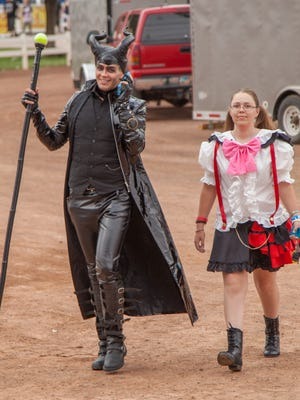 """Matthew Jacobson arrives at the Washington County Fair in full """"Male""""ficent costume with McKenna Rich."""