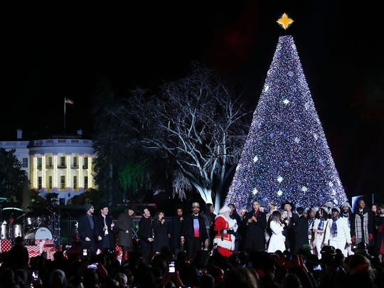 "President Barack Obama and Santa Claus lead the crowd in a ""Jingle Bells"" singalong at the National Christmas Tree lighting Dec. 1 in Washington, DC."