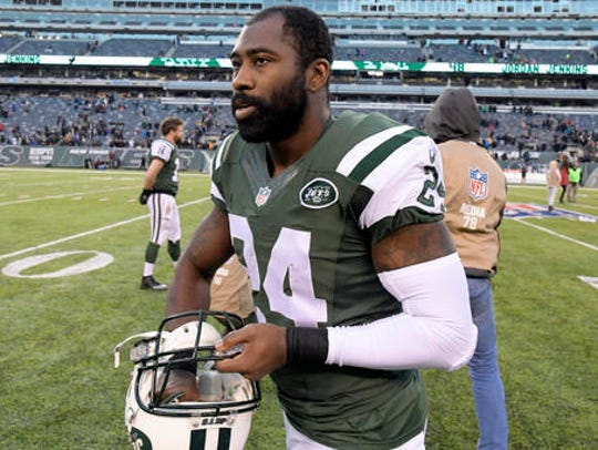 New York Jets cornerback Darrelle Revis walks off the