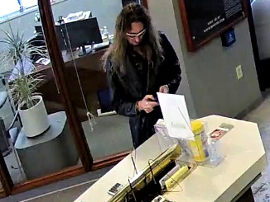 The man in the photo is a person of interest in a credit union robbery investigation.