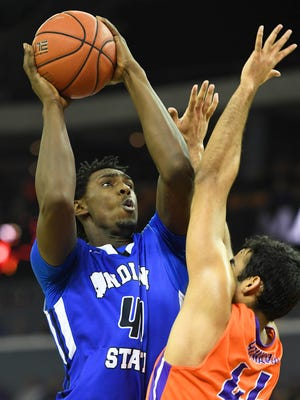 Indiana State's Emondre Rickman shoots over Evansville's David Howard as the University of Evansville hosts Indiana State at the Ford Center Saturday, February 25, 2017.
