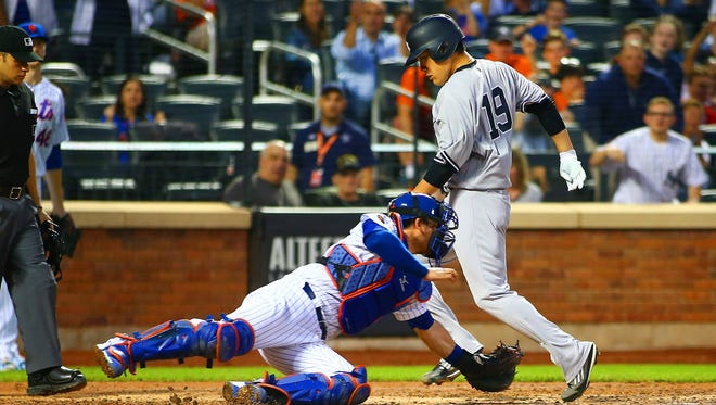 New York Yankees starting pitcher Masahiro Tanaka (19) scores on a sacrifice fly against the New York Mets during the sixth inning at Citi Field.