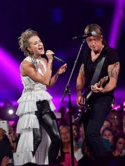 Carrie Underwood and Keith Urban perform during the