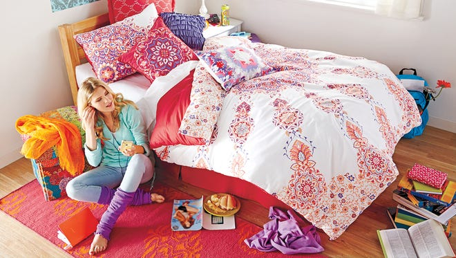 """Artistic and Morrocan-inspired, the Anthology Melody Reversible Comforter Set captures the essence of modern luxury with oversized medallion motifs in red, orange and purple on a white ground. Simply flip the comforter over for a quick change. Twin/Twin XL 2-piece comforter set includes one 90"""" L x 68"""" W comforter and one 26"""" L x 20"""" W standard pillow sham. 100% cotton sateen. Machine wash. Imported. Coordinate with other accessories in the Anthologyª Melody Comforter Set and Window Treatments for a complete look (sold separately). $99.99"""