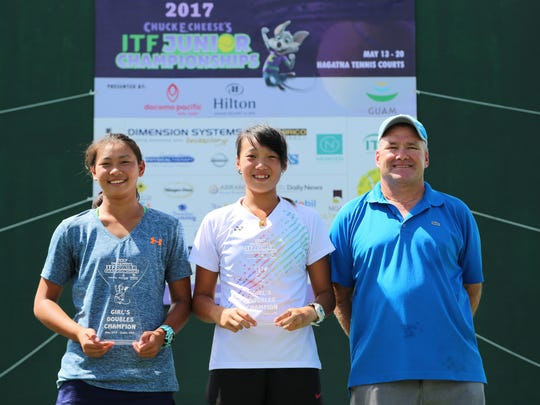 Chinese Taipei's Hsieh Yun-Chen and Wang Chao-Yi pose with the girls doubles event champions trophies of the 2017 Chuck E. Cheese's Guam ITF Junior Championships tennis tournament after the pair defeated compatriots Hsieh Chen-Hsun and Wu Fang Hsien 6-2, 6-3 in the championship match Friday at the Rick Ninete Tennis Center in Hagåtña. Also in the photo is Torgun Smith, Guam National Tennis Federation President and tournament director.