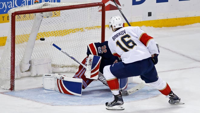 Florida Panthers center Aleksander Barkov (16) scores the game-winning goal past Rangers goalie Antti Raanta (32) in the shootout of an NHL hockey game, Friday, March 17, 2017, in New York. The Panthers defeated the Rangers 4-3.