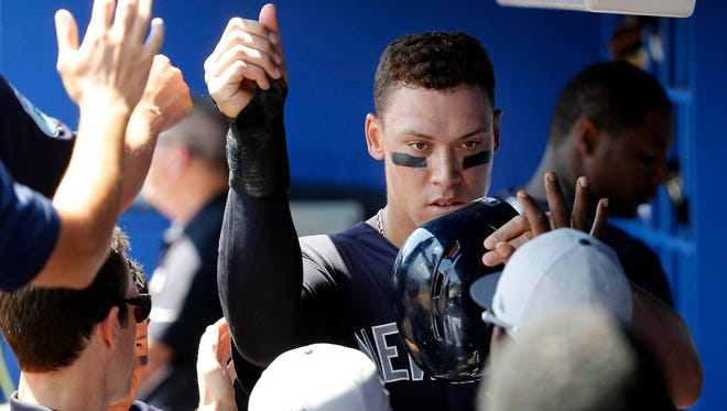 Yankees right fielder Aaron Judge (99) is congratulated after scoring a run during the fifth inning against the Toronto Blue Jays at in Dunedin, Fla., on Wednesday, Mar 29, 2017.