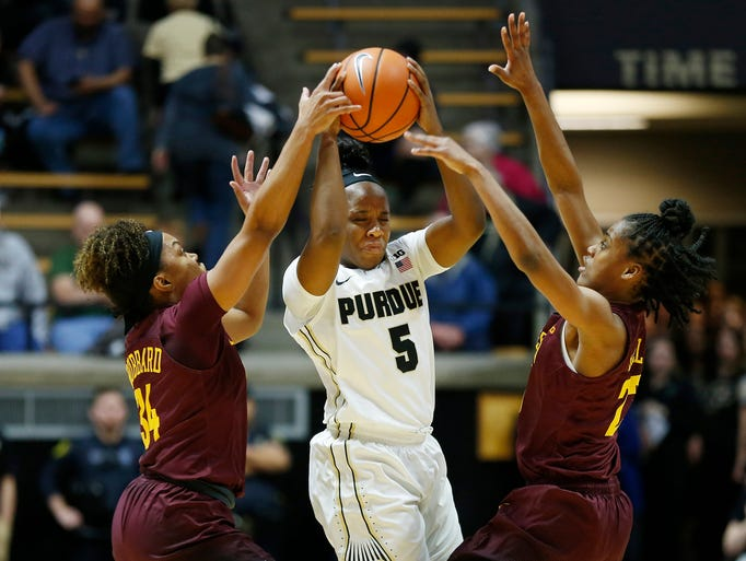 Miracle Gray of Purdue fights through the double team