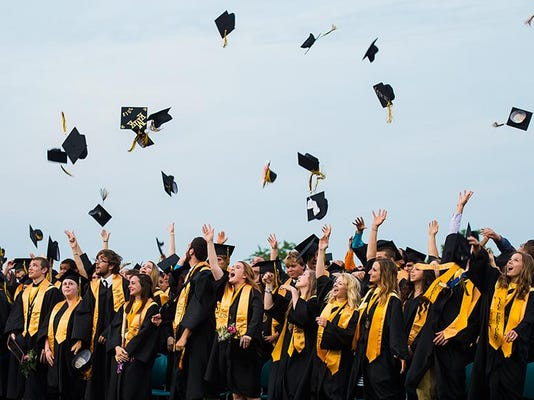 Biglerville High School grads throw their caps in the air after their commencement ceremony May 29.