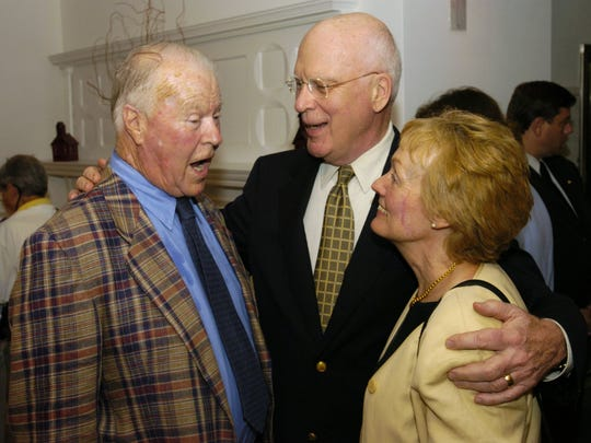 Sen. Patrick Leahy, D-Vt., and his wife Marcelle greet former Vermont Gov. Phil Hoff, left, during a celebration of Hoff's 80th birthday held by the Vermont Democratic Party on Friday evening at the Firehouse Center for the Visual Arts in Burlington. Hoff's election in 1962 made him Vermont's first Democratic governor in over 100 years.