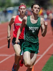 Novi's Nate Wood and Josh Momeyer of Churchill, battle for the lead in their leg of the 4X800 relay.
