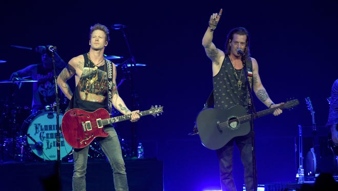 Florida Georgia Line (Brian Kelly, left, and Tyler Hubbard) performs on Jan. 31 in Phoenix.