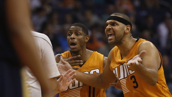 Suns' Brandon Knight (11) and Jared Dudley (3) complain to an official during a game against the Pelicans at Talking Stick Resort Arena on Dec. 11, 2016 in Phoenix.