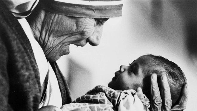 Mother Teresa, cradles a baby in a this 1979 file photo.